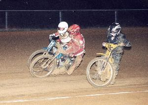Alex Heath (r.) slides low while Dave Clark (c.) and
